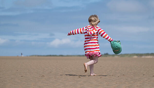 Child standing on beach