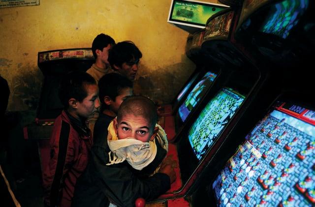 boy in video game shop
