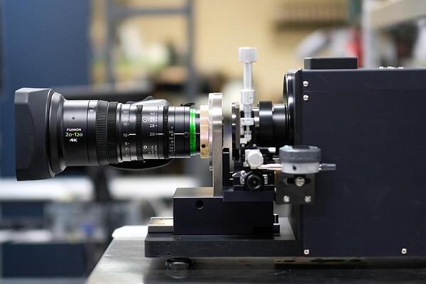 SYDNEY AUSTRALIA, JUNE 2019 - the FUJINON projector in operation with mounted cine lens.