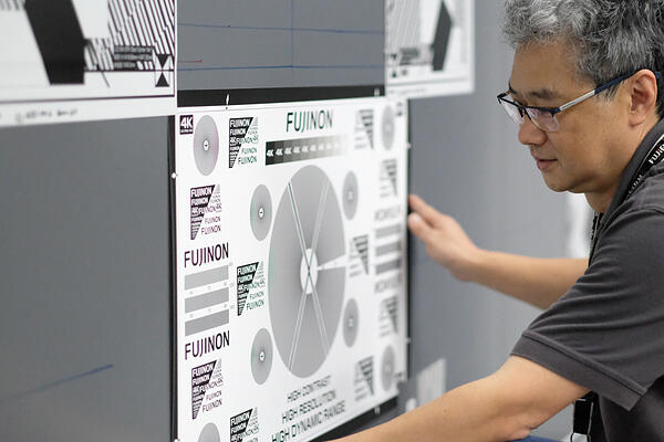 SYDNEY AUSTRALIA, JUNE  2019 - Terry Kasai adding a FUJINON focus chart to the magnetised wall.