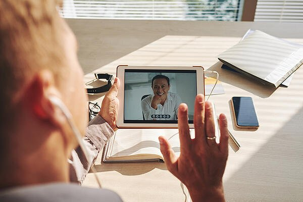 video-conference-on-tablet-2CEN3F8